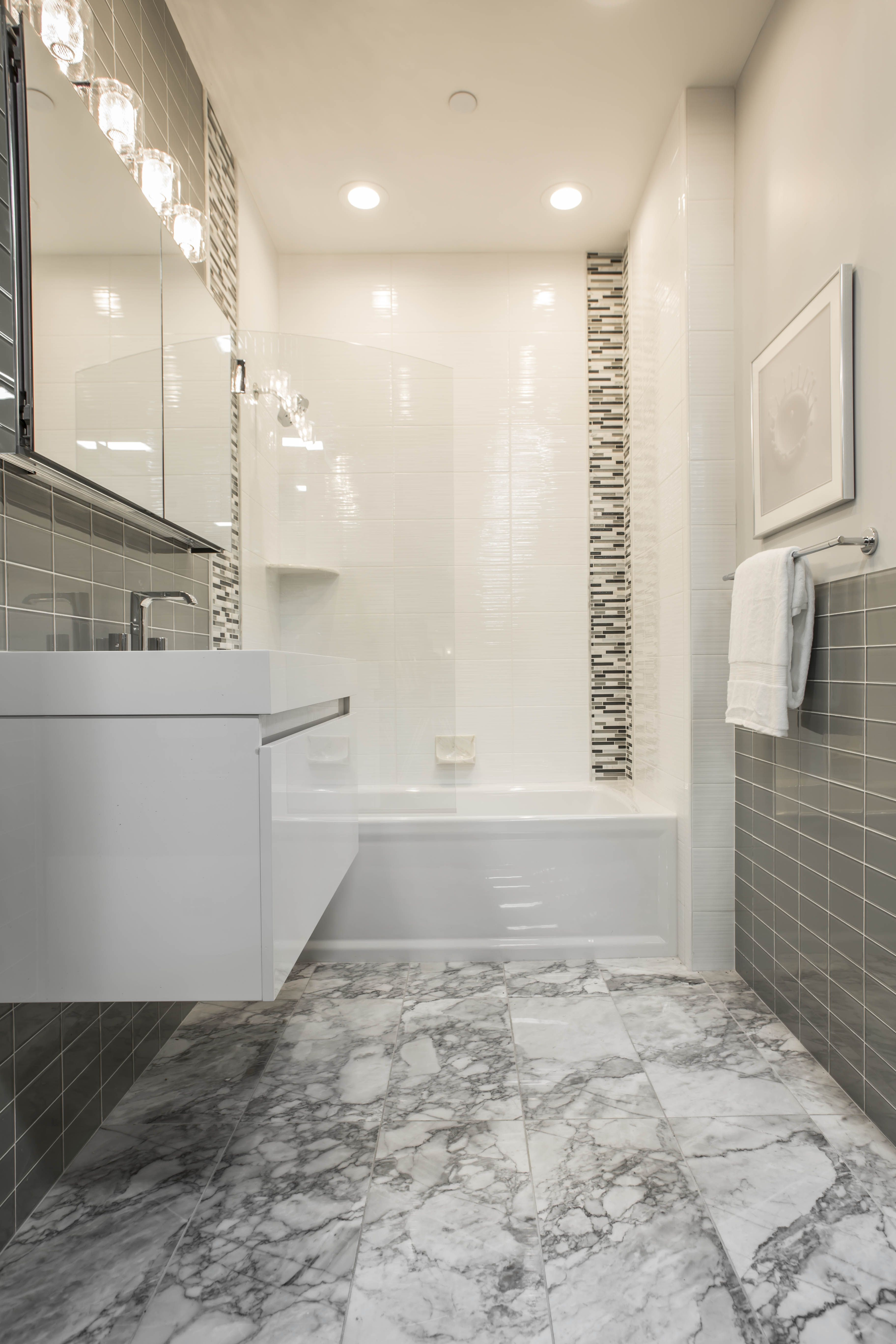 Mixing Marble Glass And Ceramic Tiles Adds Interest And Allows You To Be More Flexible Wit Marble Bathroom Floor Glass Floor Tiles Bathroom Bathroom Wall Tile