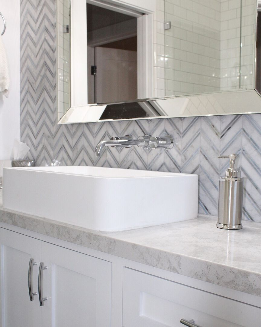 - Vessel Sink With Wall Mount Faucets And Marble Tile Backsplash