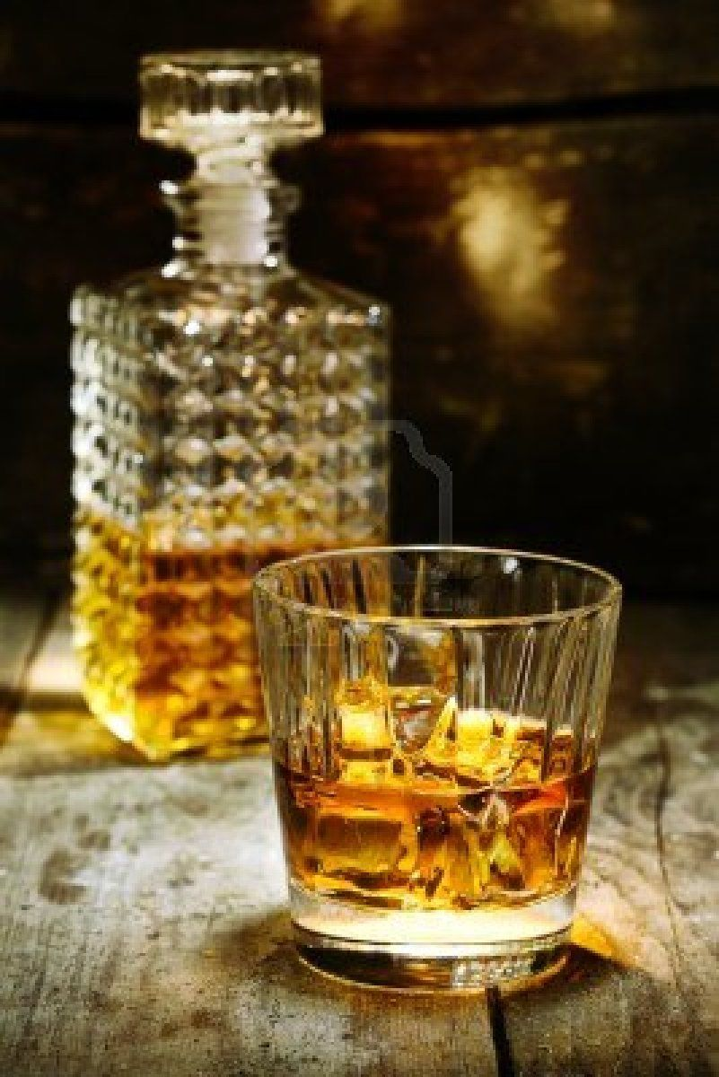 Glass and bottle of hard liquor like scotch bourbon for Alcohol bottles made into glasses