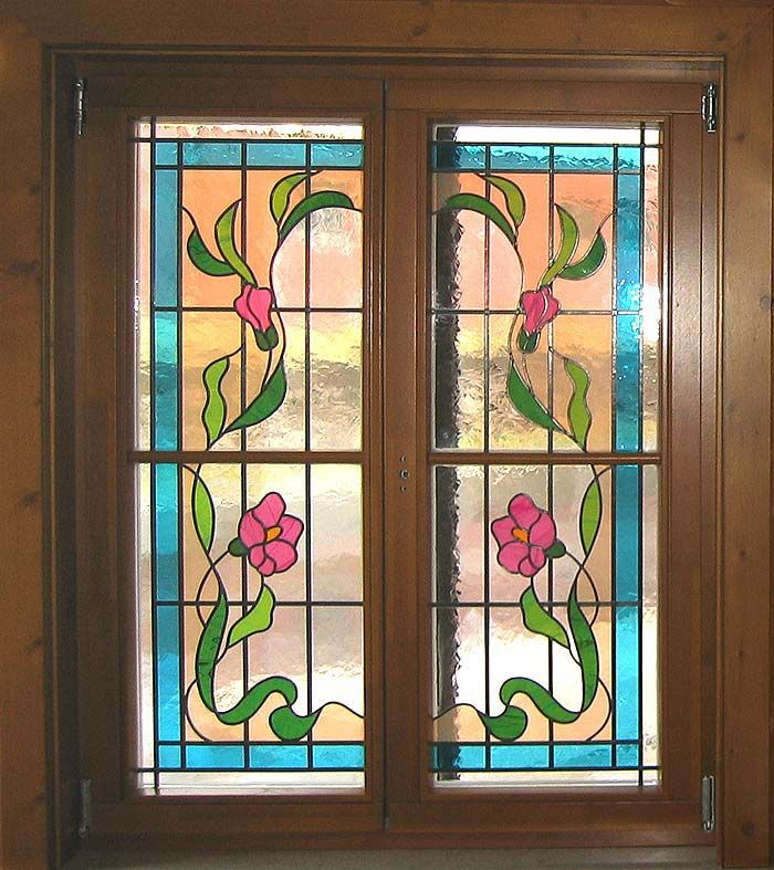 Stained glass window with facing panes.  This pleasant design would allow one to add a simple central panel of grid work if necessary for a 3-piece set.