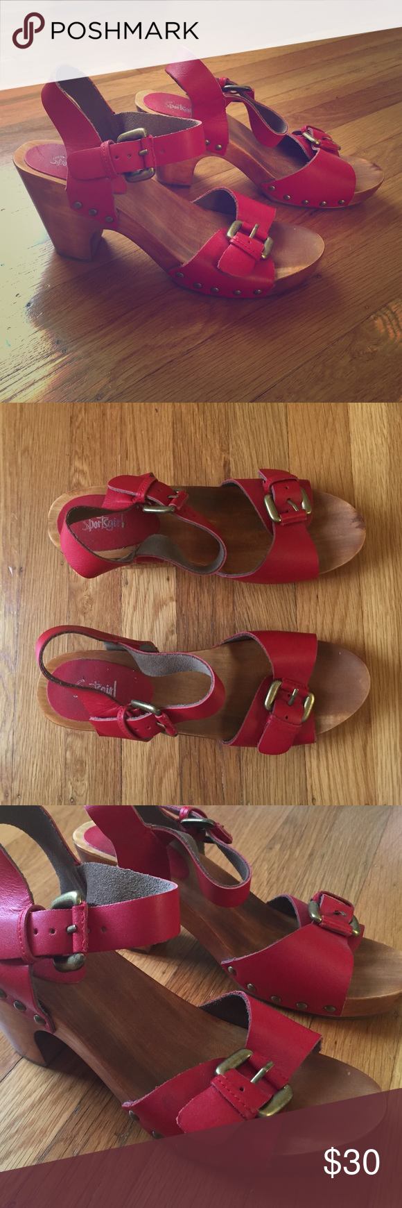 Red clog sandals Wooden clog sandals with red leather straps and gold buckle detailing. 3 inch block heel. Really cute with jeans or dresses!! Flirty and girly. Shoes Sandals