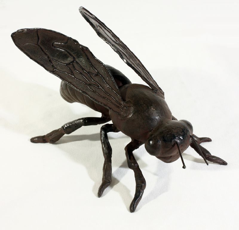 This Black Cast Iron Bumblebee Statue Makes A Whimsical Addition To Garden Decor