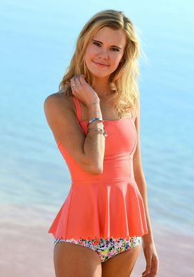 2b7ee768e5 Coral Peplum swimsuit with floral bikini bottoms from Divinita Sole by DM  Fashion. Perfect swimsuit for Juniors!