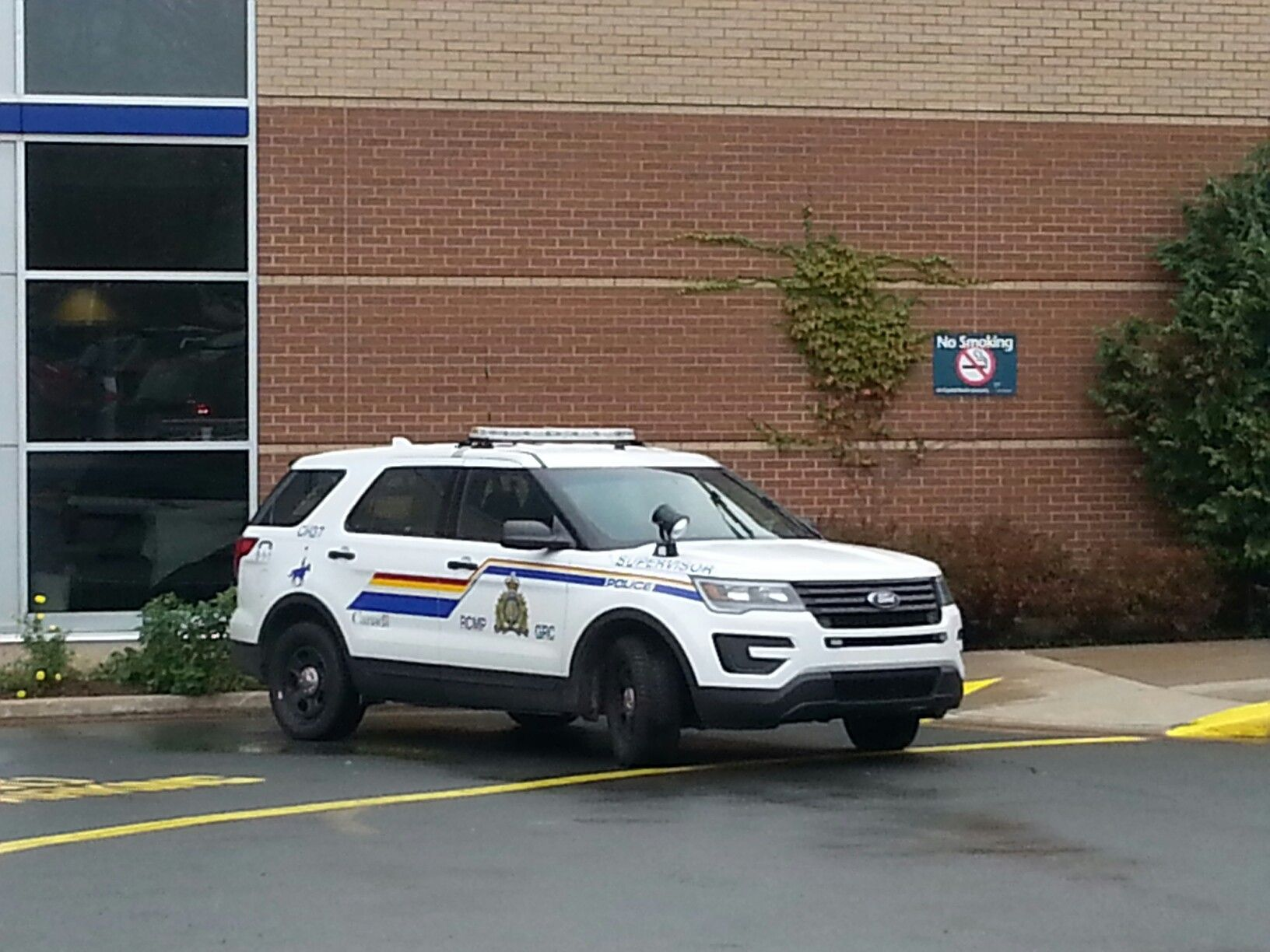 A Royal Canadian Mounted Police Supervisor S Suv Outside The