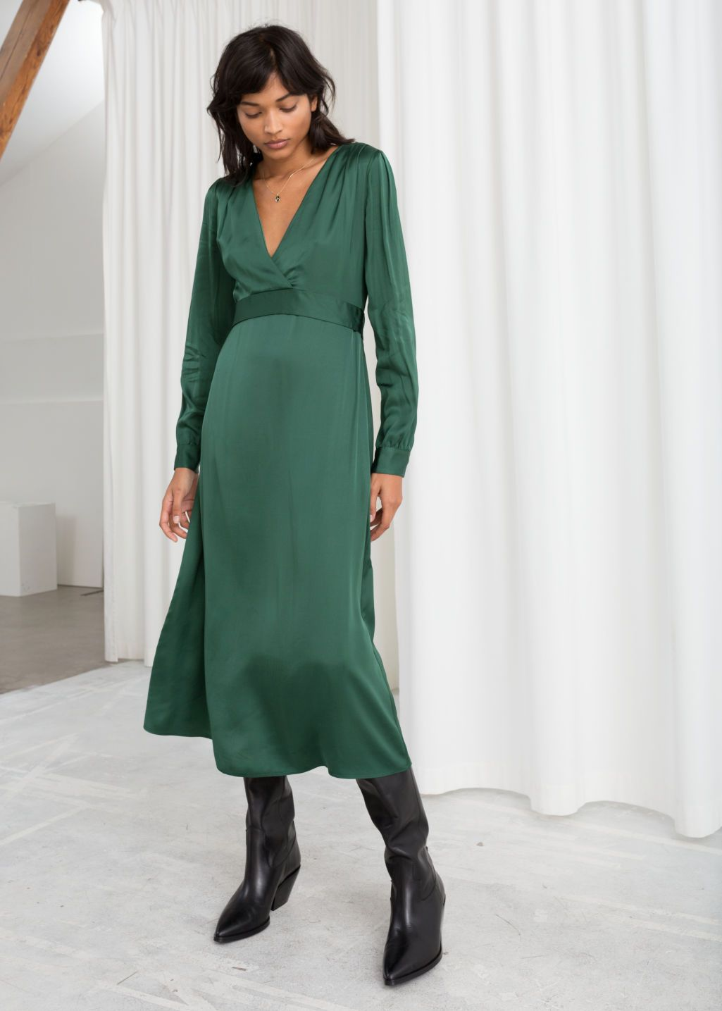 Model front image of stories plunging ruched midi dress in