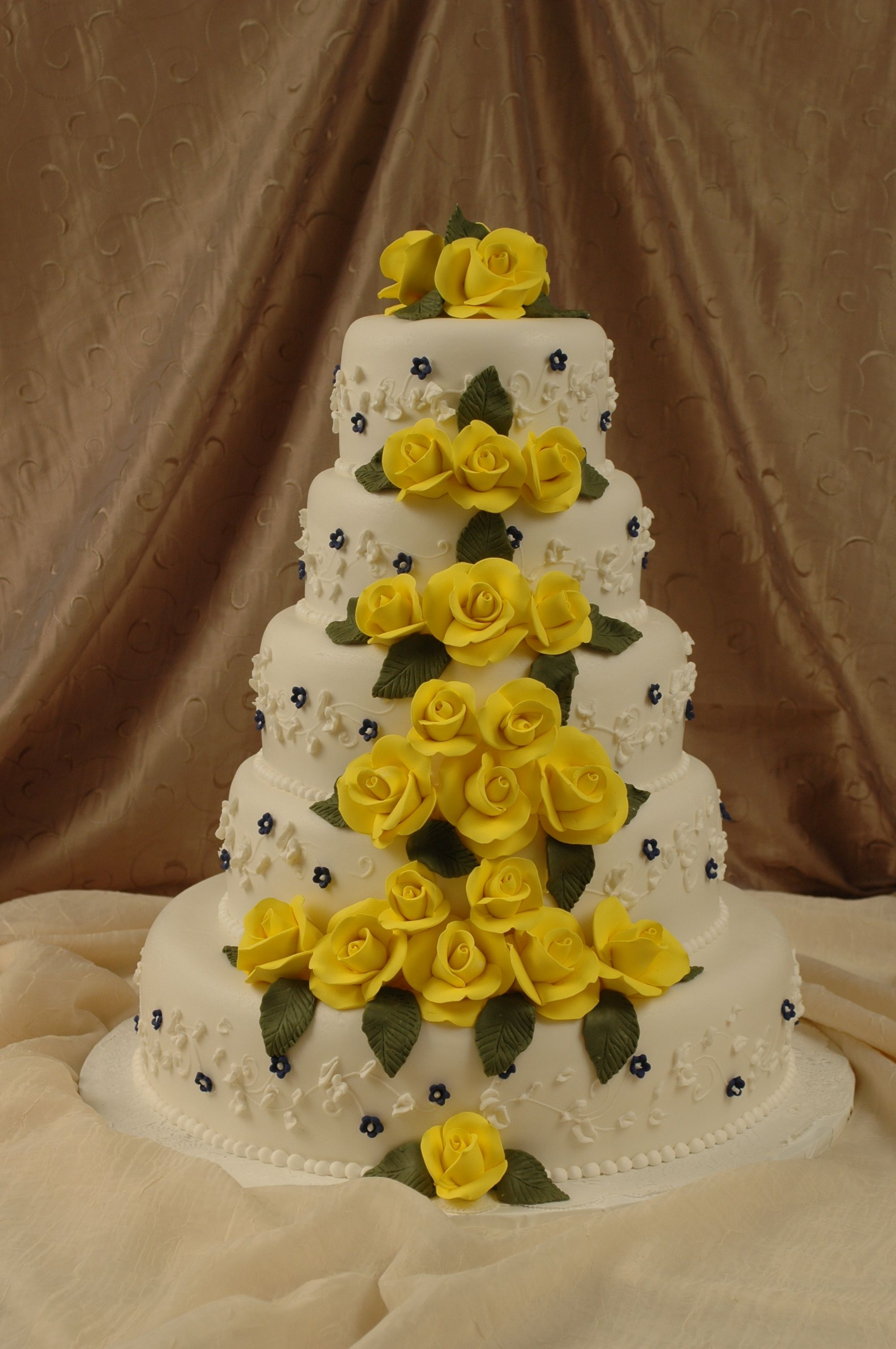 Five tier fondant wedding cake with bright yellow fondant roses and ...