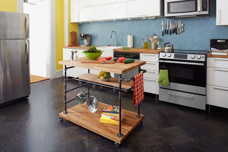 Combine iron threaded pipe and butcher block to create a one-of-a-kind kitchen centerpiece! If you're hankering for a bit more elbow room to prepare meals, this rolling island lets you make the most of the floor plan you already have. | Photo: Ryan Benyi