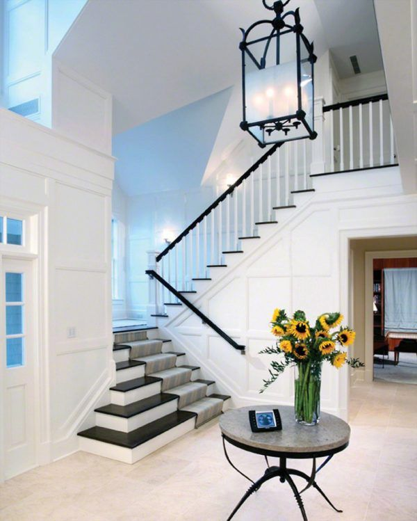 modern entryway lighting. Aesthetic-modern-entryway-lighting-fixtures-using-black-cage-chandelier-over-round-granite-table-tops-with-clear-glass-flower-vases-alongside-white-oak- Modern Entryway Lighting