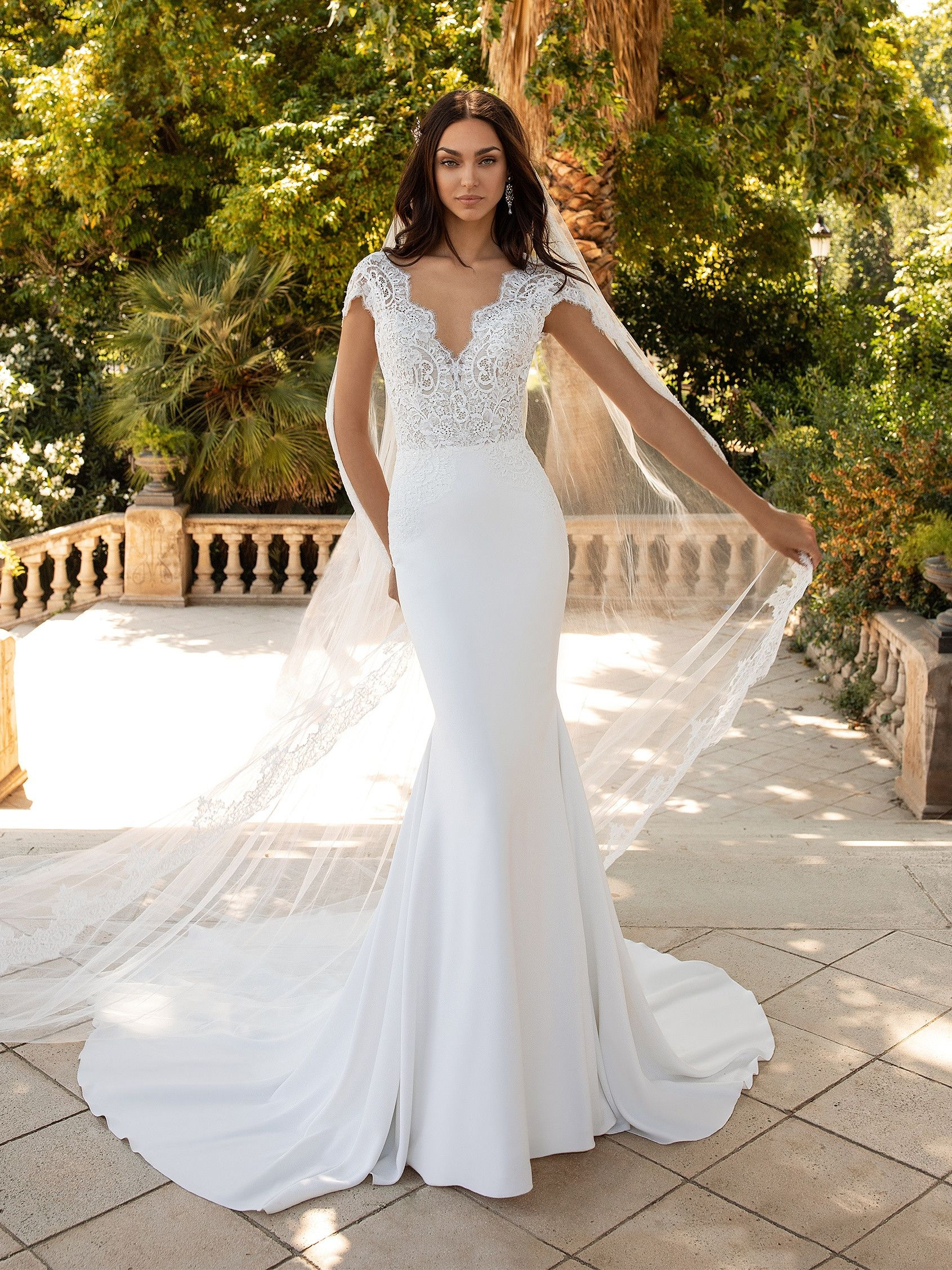 Milady Is An Elegant Crepe Wedding Dress With Lace Bodice V Neck And Short Sleeves Adorned Pronovias Wedding Dress Mermaid Wedding Dress Lovely Wedding Dress [ 2255 x 1691 Pixel ]