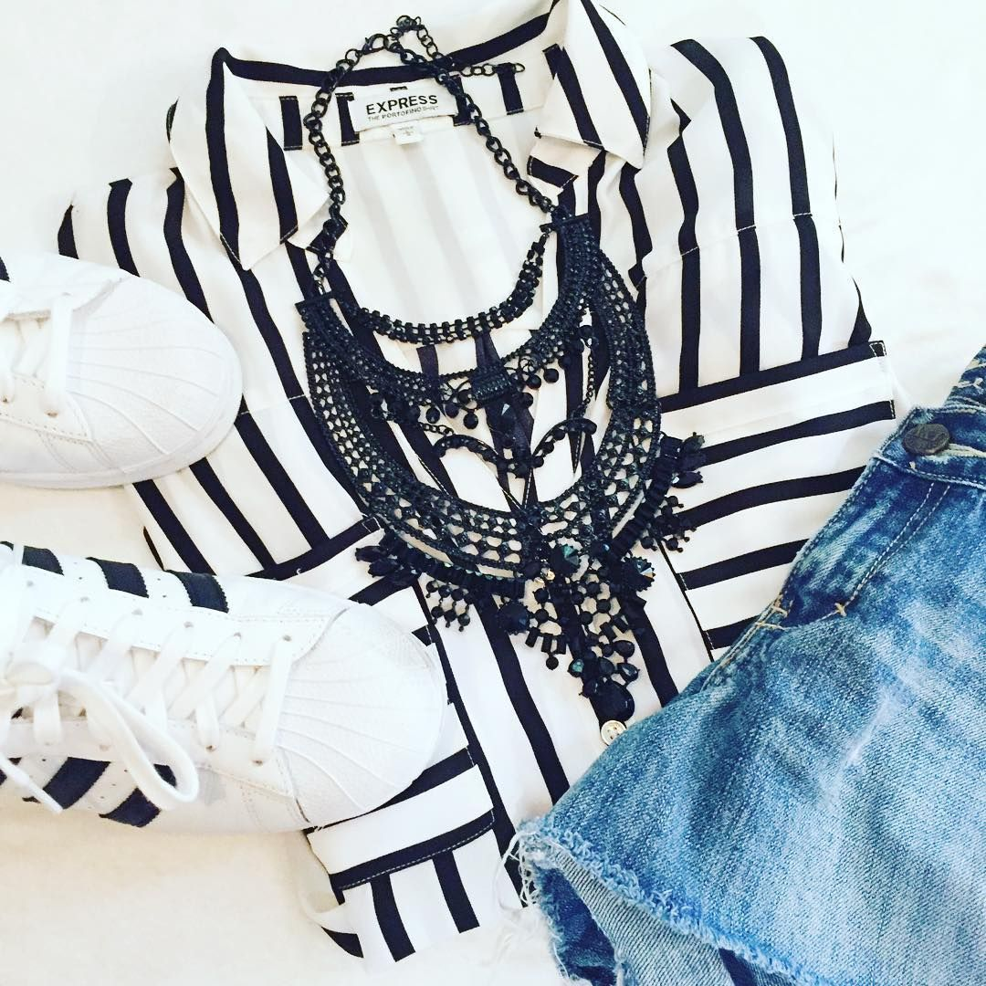 Black and white flat lay featuring our Collette Statement necklace. #flatlay