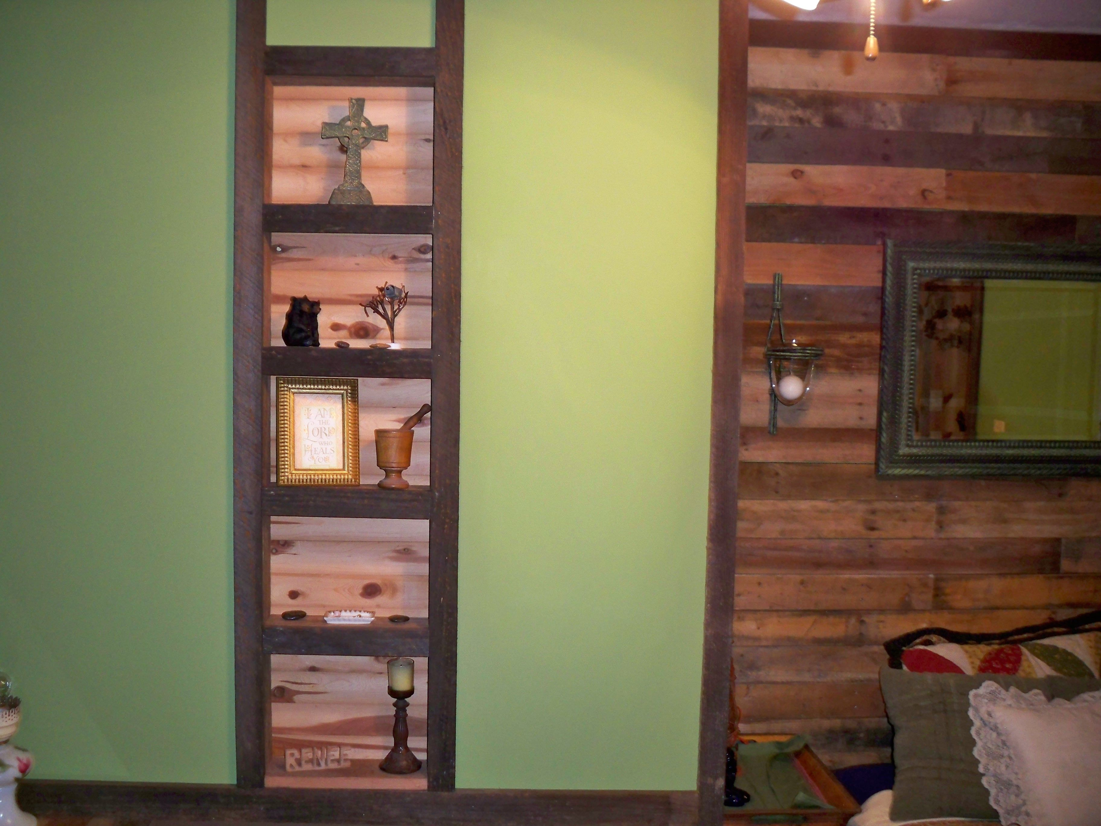 Shelves in between two wall studs Trim is old barn wood The back