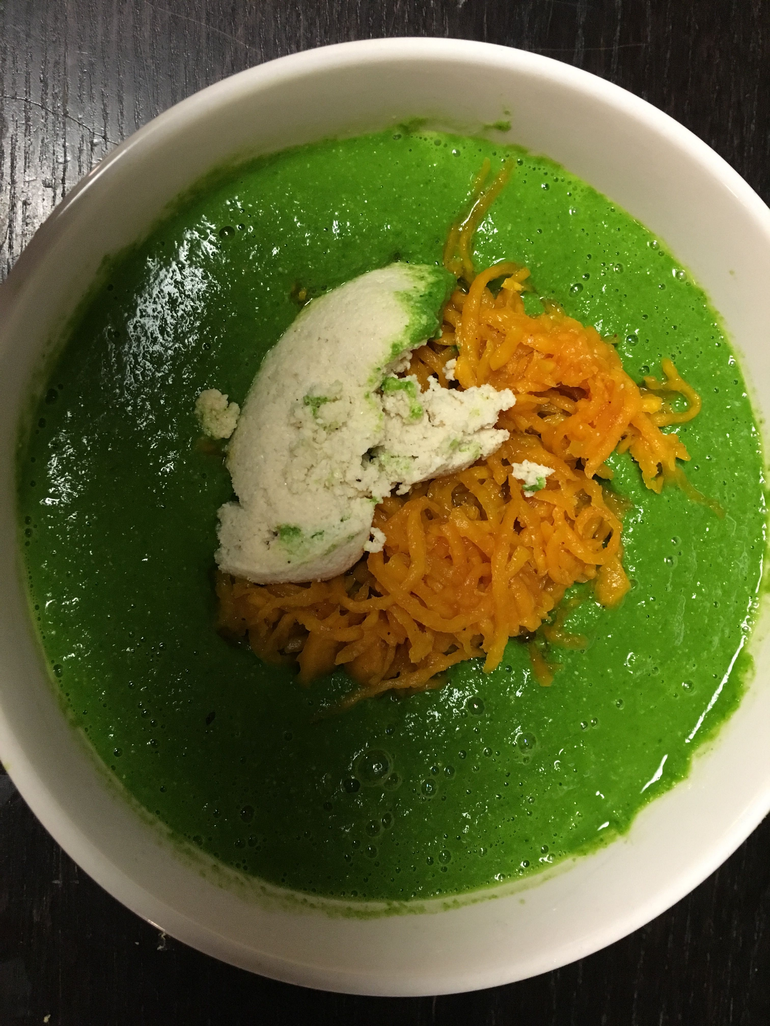 Creamy vegan kale soup with fermented golden beets and almond cheese