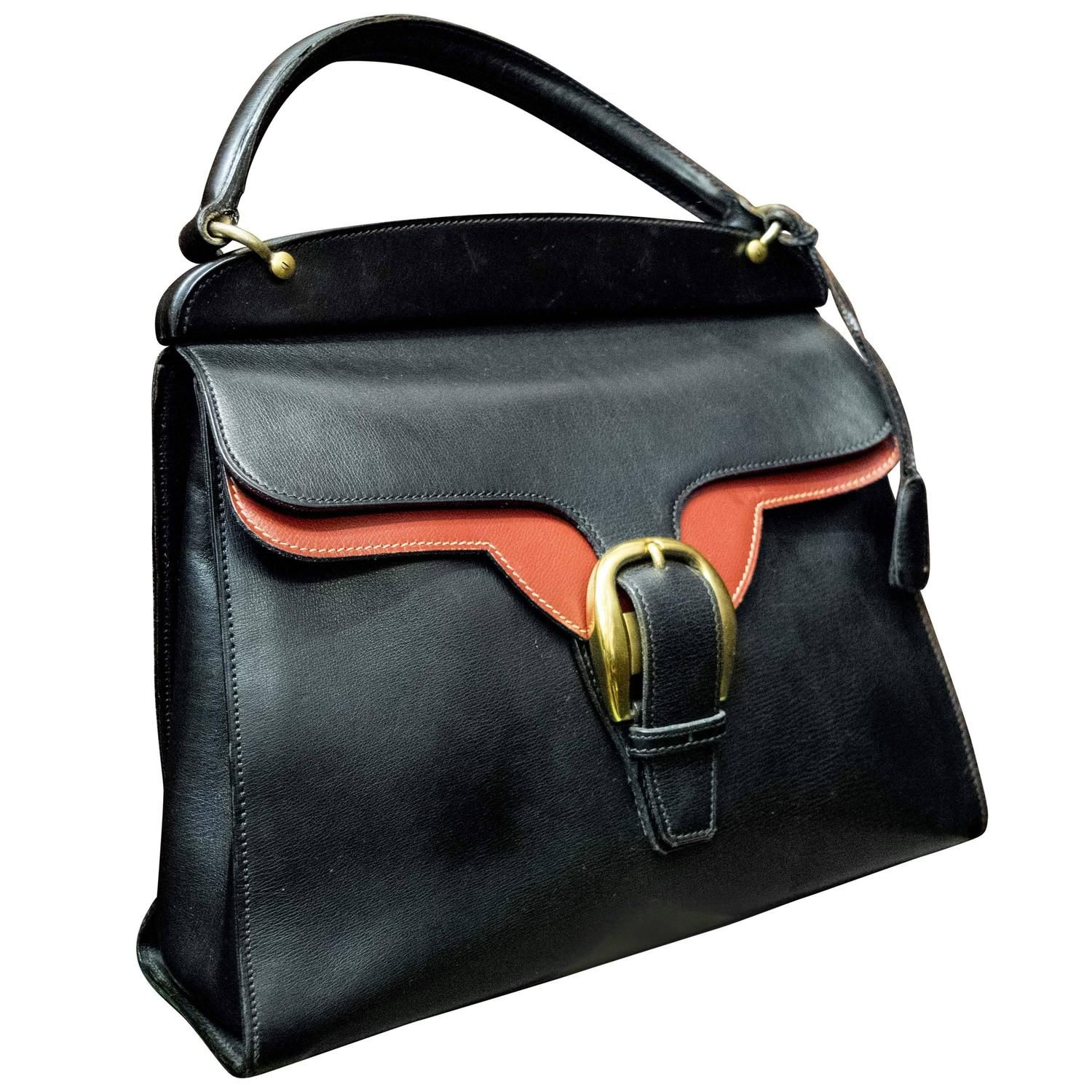 1950s Gucci Black and Red Leather Handbag  | From a collection of rare vintage top handle bags at https://www.1stdibs.com/fashion/handbags-purses-bags/top-handle-bags/