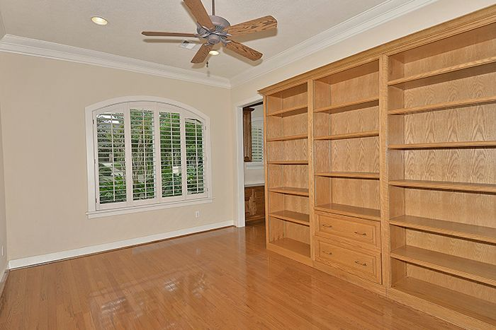 Hardwood flooring and built-ins featured in the study