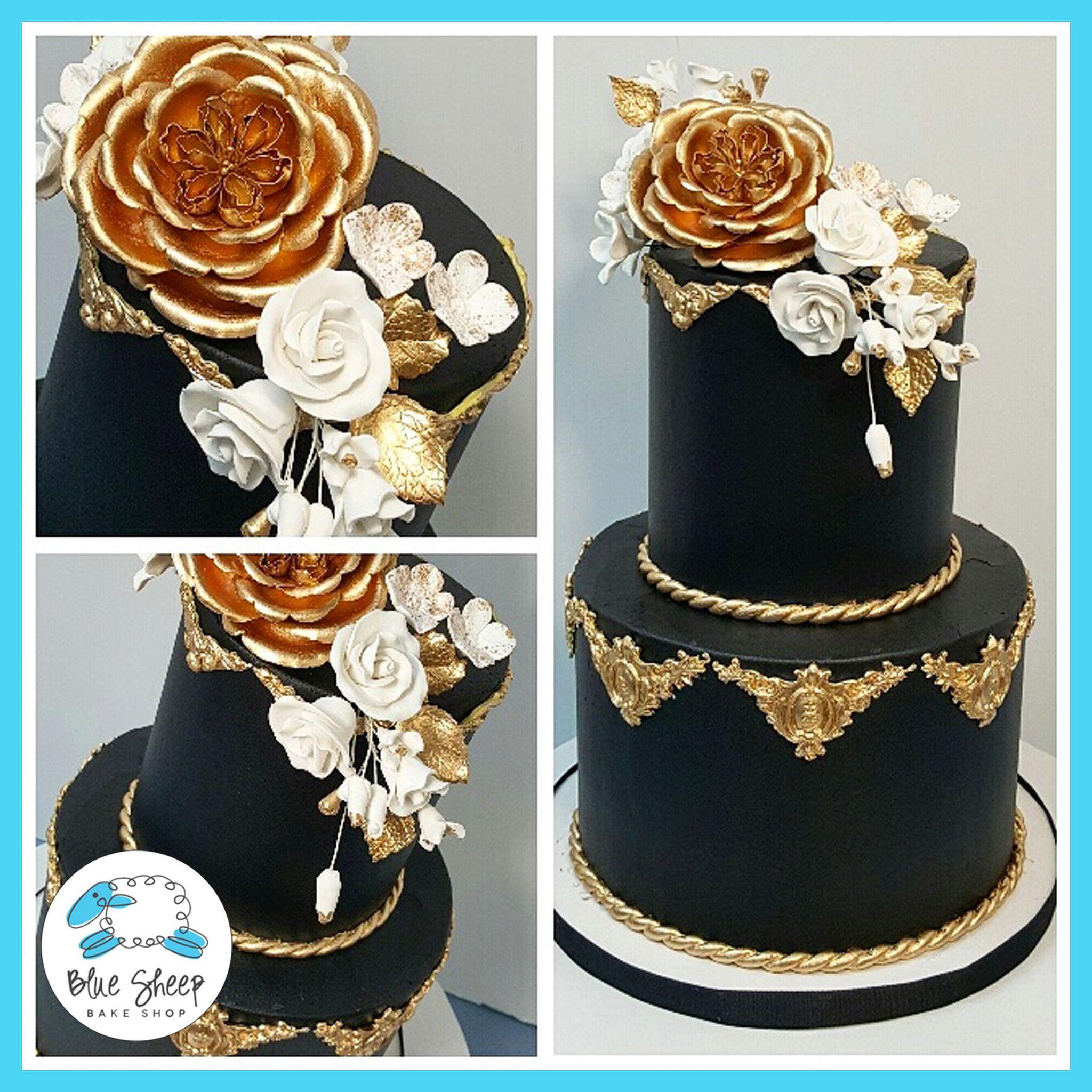 Black and gold buttercream wedding cake nj