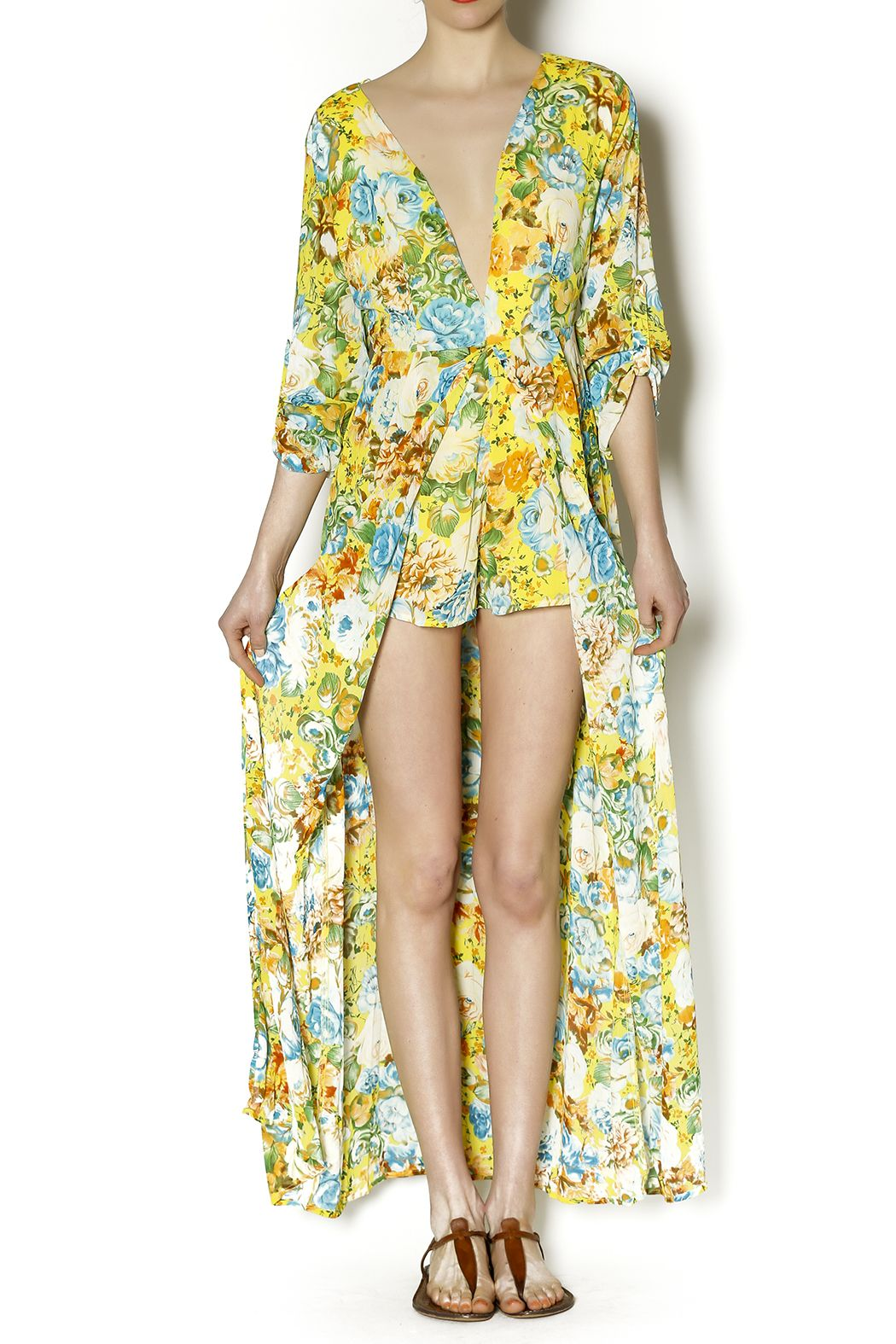 097073f0a92f Floral printed romper with a maxi skirt overlay. This romper features lined  shorts