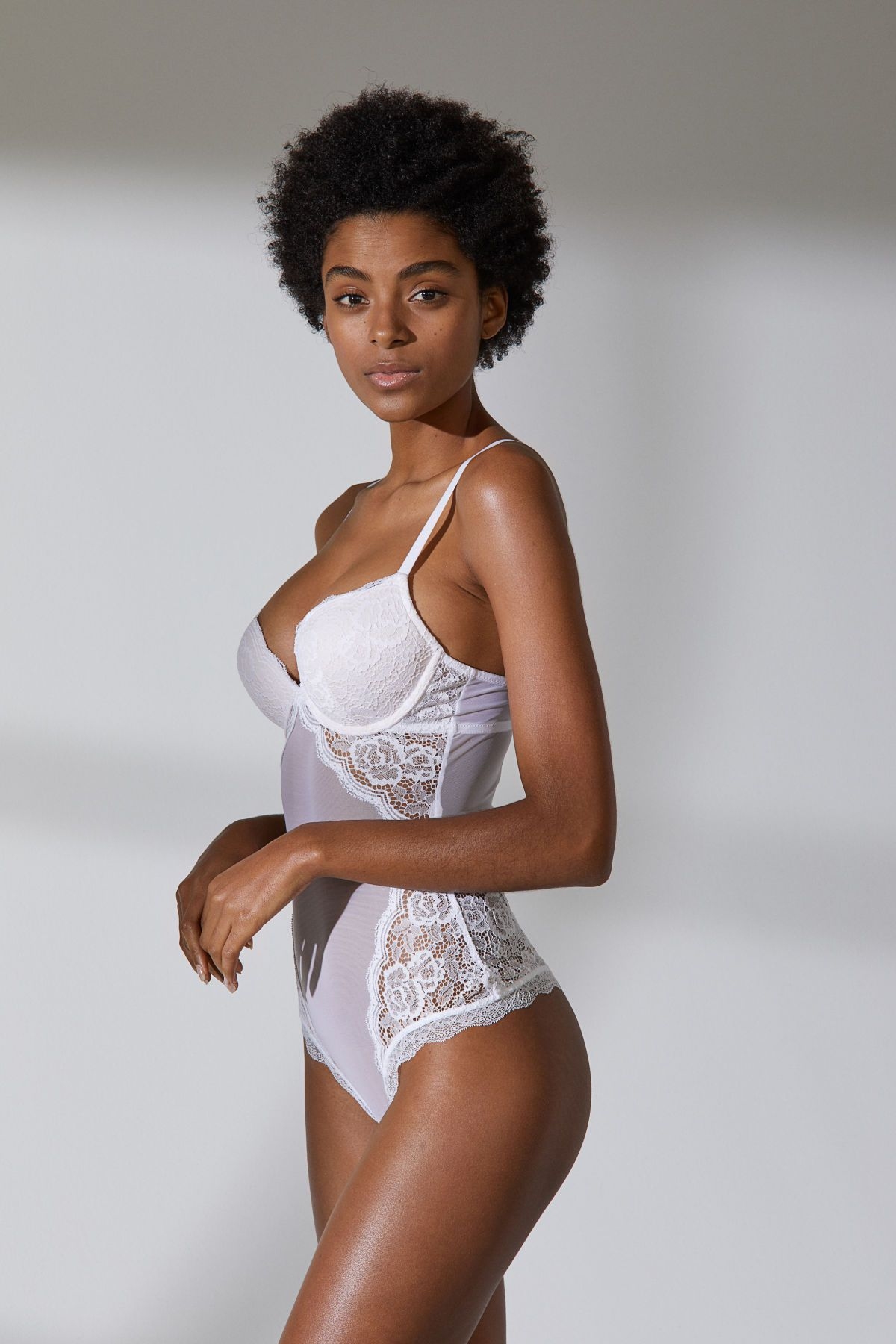 8d4e18d6604 White. Bodysuit with integral