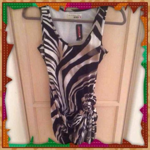 NWT Animal print swirl side knot dress NWT Nwt Styles brand colors black white grey tank top the dress lifts into a knot up on the thigh very cool google for twist knot thigh dress styles brand new cotton breathable great for parties comfortable Medium/large dress very sexy where the knot is it comes up high on the thigh to show more leg styles Dresses Mini