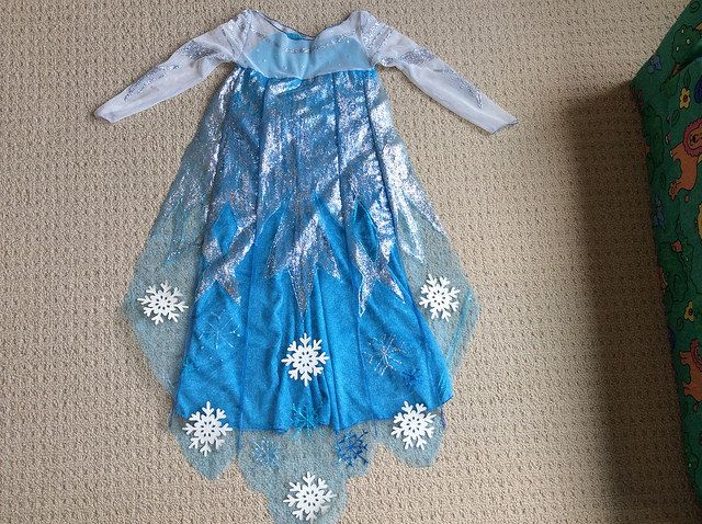 Finished elsa dress!  This is the back.  I used glitter, fabric paint and decals on the cape and sleeves.