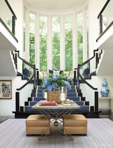 bold striped staircase runner is tempered by natural toned entry furniture home design also veranda magazine verandamag on pinterest rh