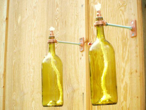 old wine bottles, burning twine & hardware.....backyard lighting!