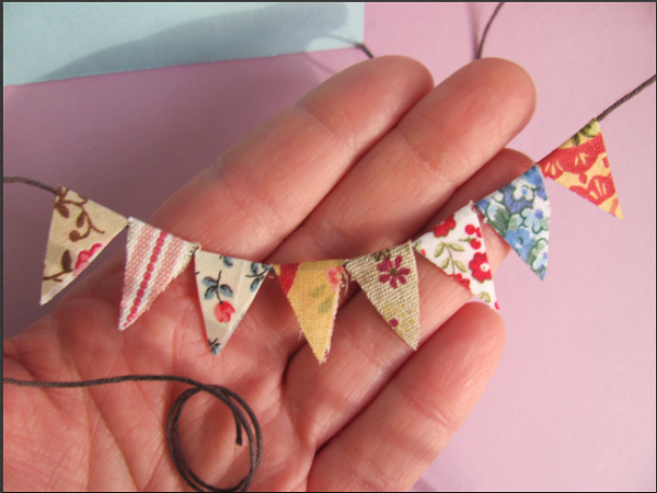 Miniature scrap fabric pendant flags for the hot air balloon project