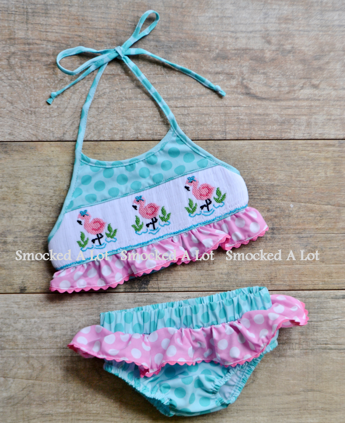 d80b10d232e1f Smocked Girls Flamingo Aqua and Pink Polka Dot Swimsuit Bikini- only $29!  Find this adorable swimsuit and more at www.facebook.com/smockedalot