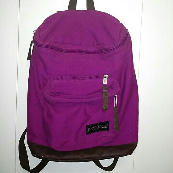 Fuschia Jansport Very cute backpack with interior laptop sleeve. Two zippered pockets on front. There is some peeling on the bottom and corners of the bag. Jansport Bags Backpacks