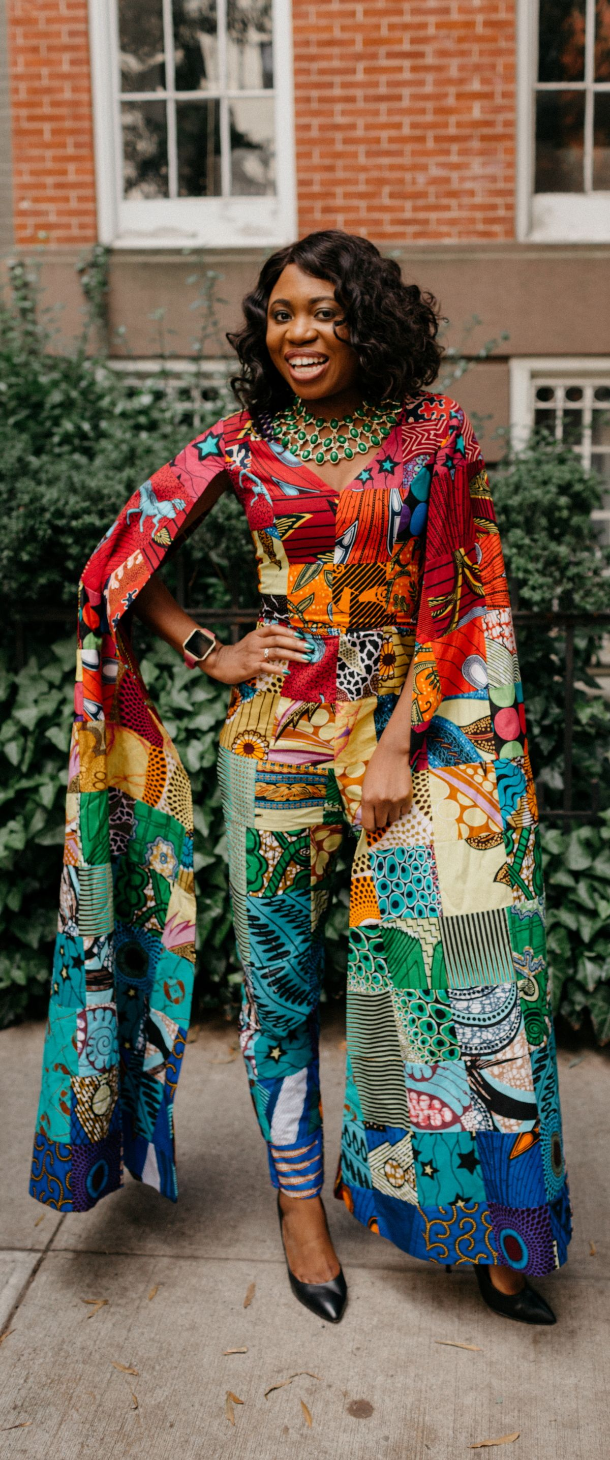 789f575b768 How I love the dramatic cape sleeves of this rainbow patchwork ankara  jumpsuit. I m sure she turned heads when she showed up to New York Fashion  Week ...