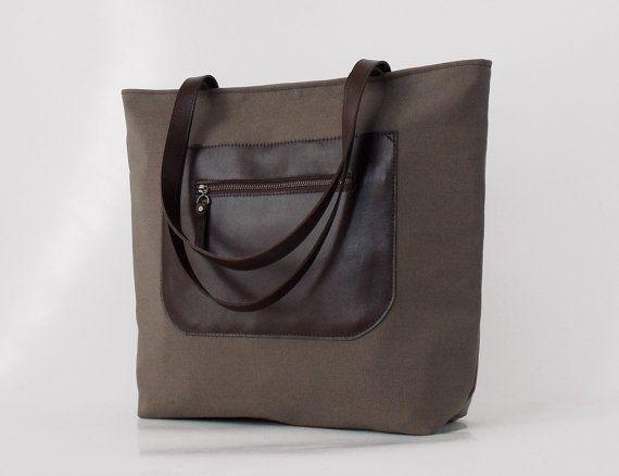 Leather front pocket, chocobrown tote / diaper bag / shoulder bag, leather handles,11 pockets.  Design by BagyBags