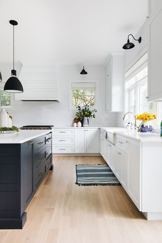 Modern Farmhouse Kitchen Painted in Sherwin Williams SW 7006 Extra White; one of the Whitest Paint Colors You Can Find #greykitcheninterior
