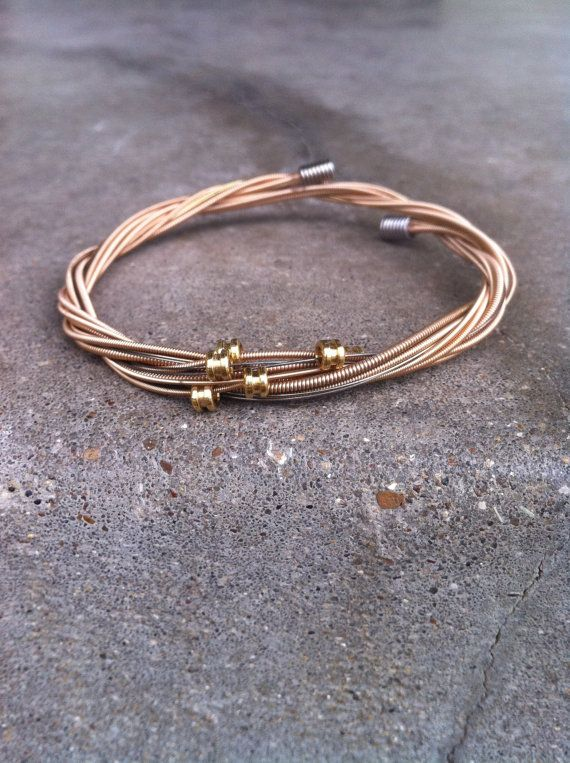 recycled guitar string bracelet in salmon super cool part of the proceeds go towards a music. Black Bedroom Furniture Sets. Home Design Ideas