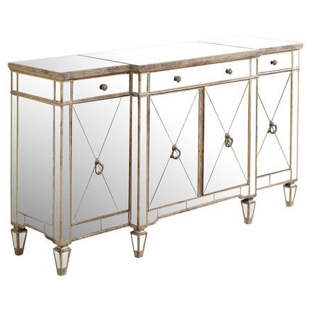 Perfect for stowing dishware and linens in the dining room or crafting a lovely tabletop vignette in the entryway, this elegant wood buffet showcases glamoro...
