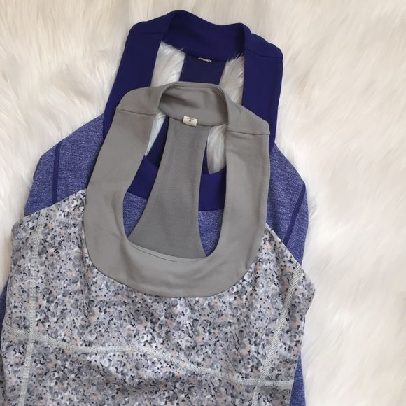 Lululemon Scoop Neck Tank Bundle Petite fleur print is in excellent gently used condition and purple shows some signs of wear in fabric. The purple one was dried in dryer. Cup inserts not included. lululemon athletica Tops