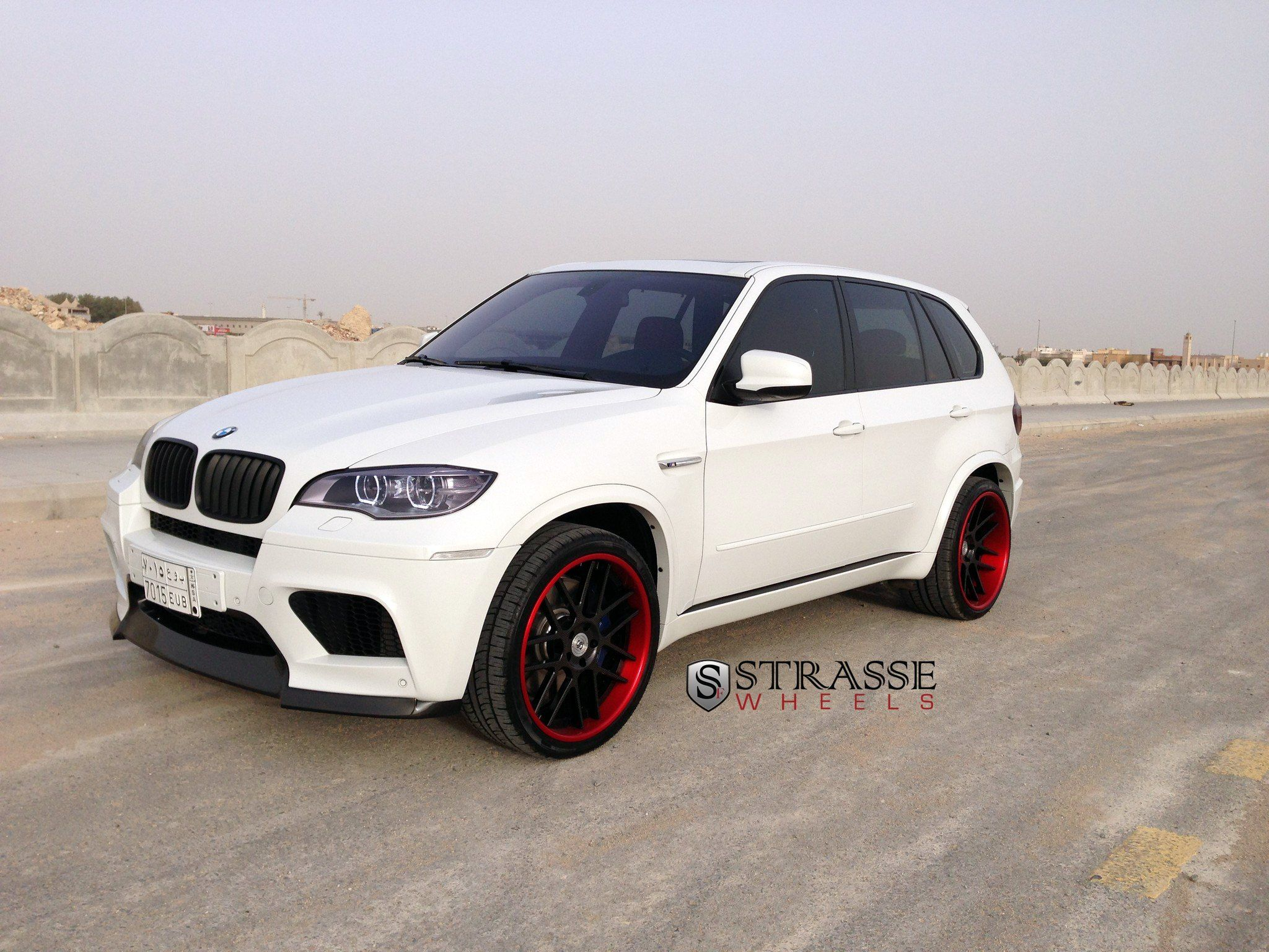 White Bmw X5 On Contrasting Matte Black Strasse Wheels Featuring