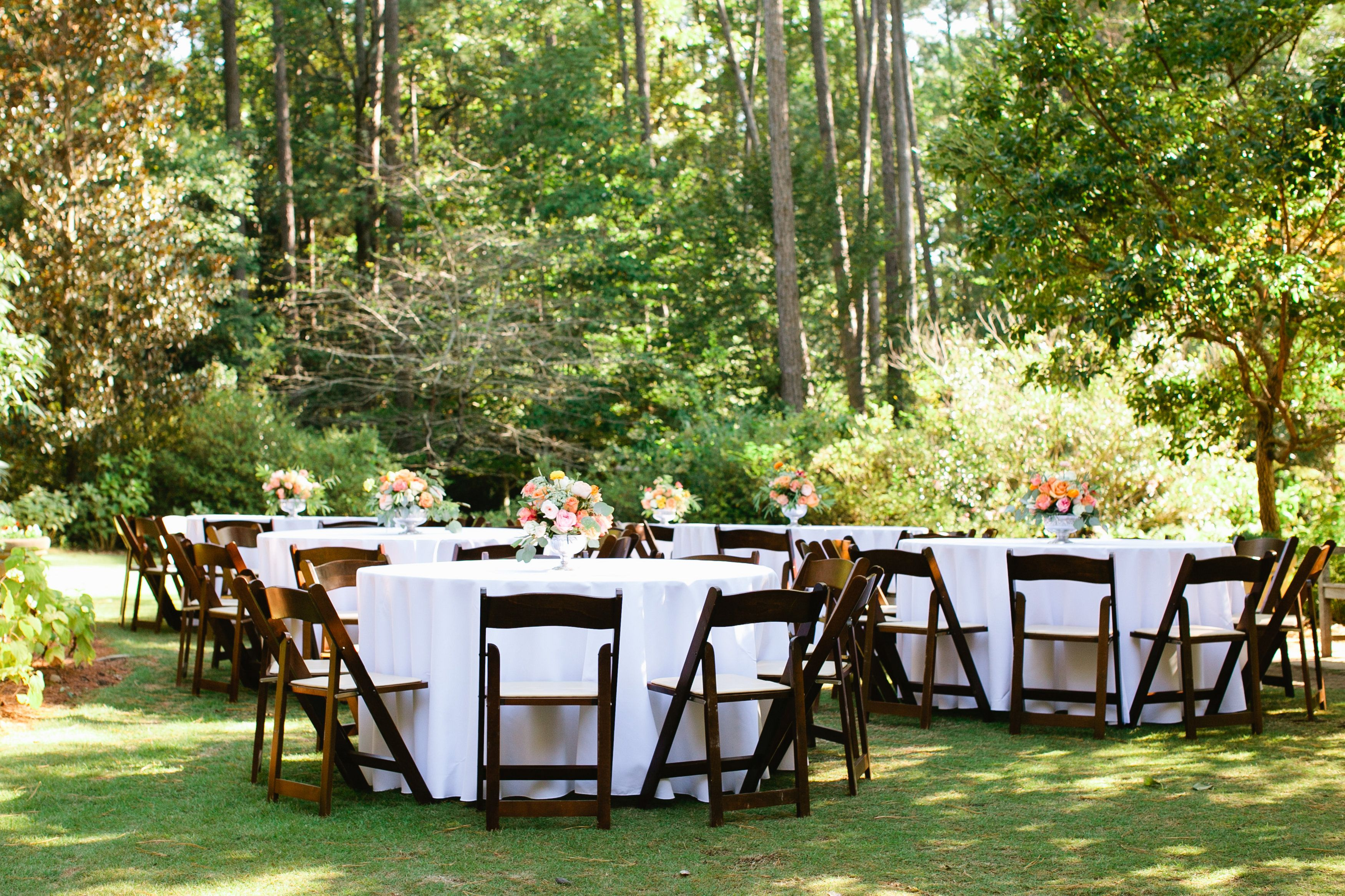 Guest Tables Set Up In The Shade Garden Near The
