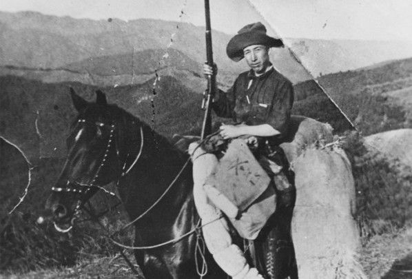 Tom Cheney was a member one of the original homesteader families in Topanga, Calif. He is pictured here on his horse with a rifle, ca. 1910. San Fernando Valley History Digital Library.