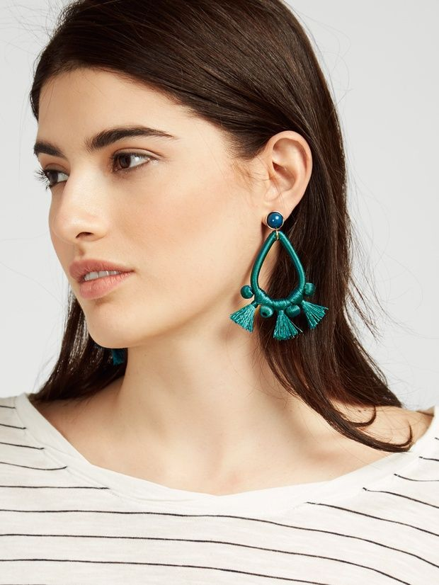 These threaded hoops infuse a dose of saturated color, complete with flirty tassels. Handle with Care Instructions: We recommend storing on a jewelry stand to avoid threads bending. Wrap tassels for travel to keep their shape.