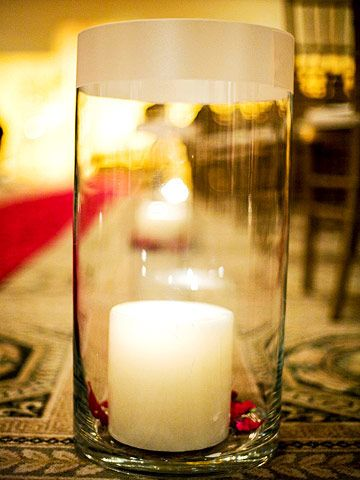 Candle-Lit Glow - these were used in place of flowers (major budget saver), and were placed at every-other aisle instead of every aisle.