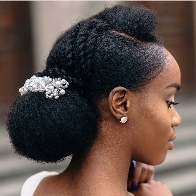 Natural hair updo styling for black women to style their hair at home.