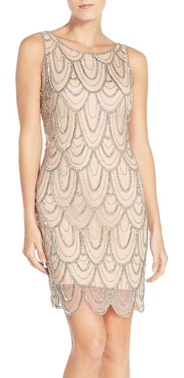 embellished mesh cocktail dress by Pisarro Nights. Strands of gleaming beads and sequins create an Art Deco-inspired pattern atop the mesh overlay o...