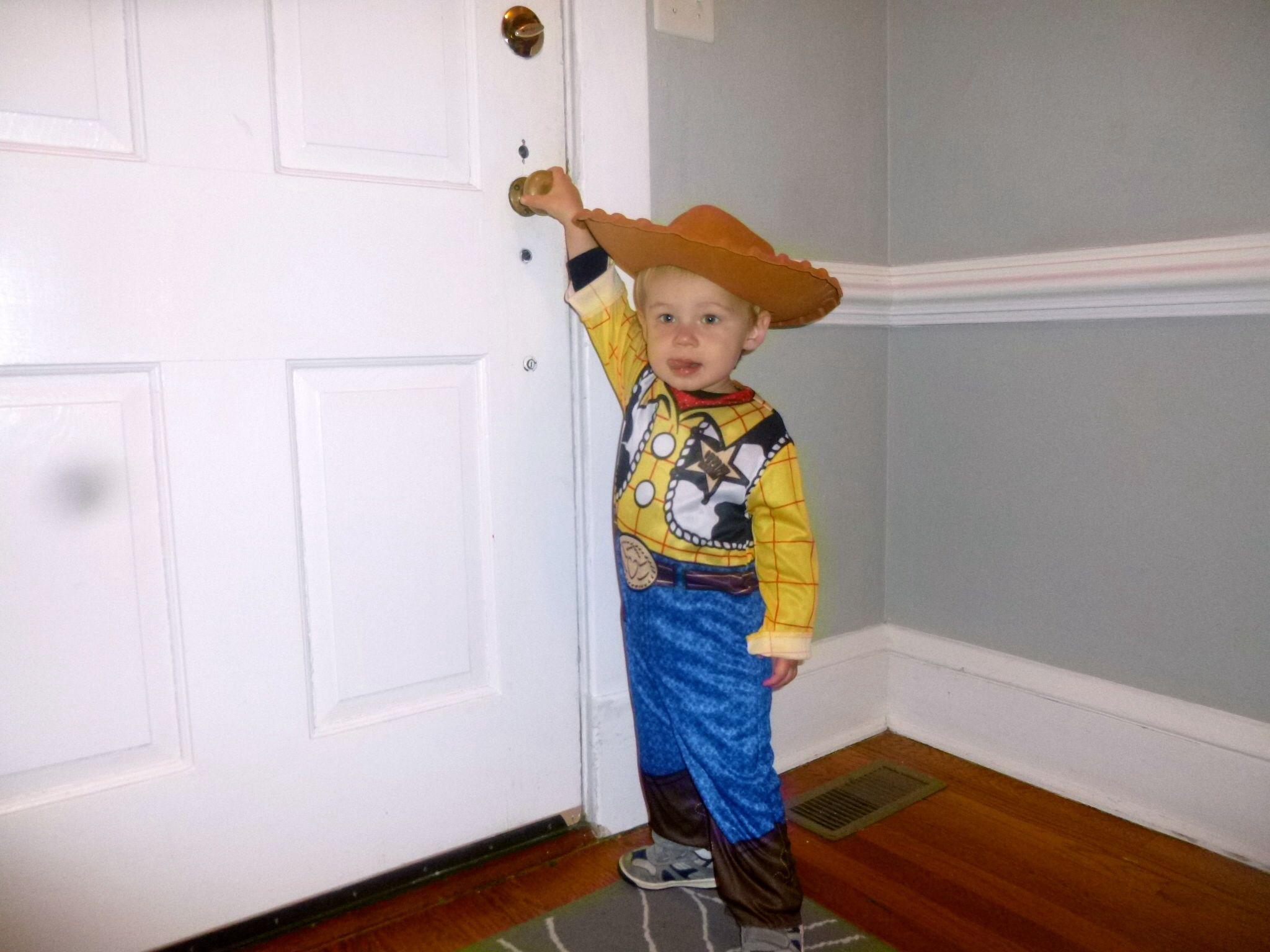 My angel boy dressed like Woody for Halloween!