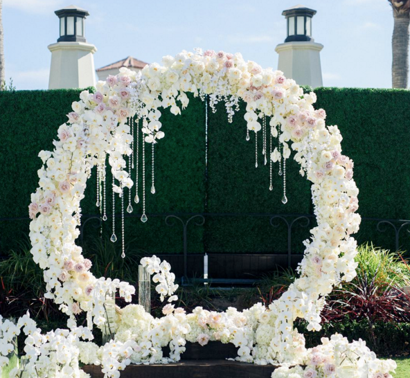 Wedding Altar Design Resource: A Floral Arch With Hanging Crystals Would Beautifully