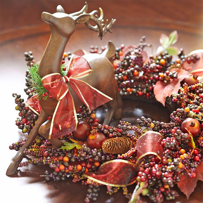 Berry Wreath And Reindeer Ornament Used As A Centerpiece