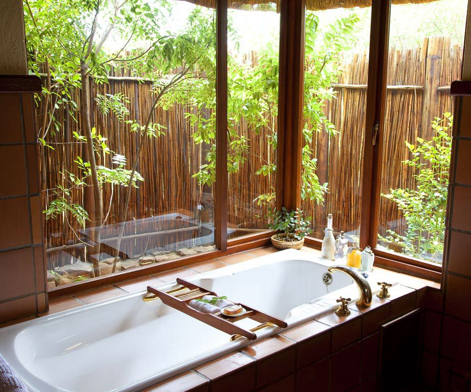 A luxurious bathroom, with a garden view in a modern game lodge in The Kruger National Park