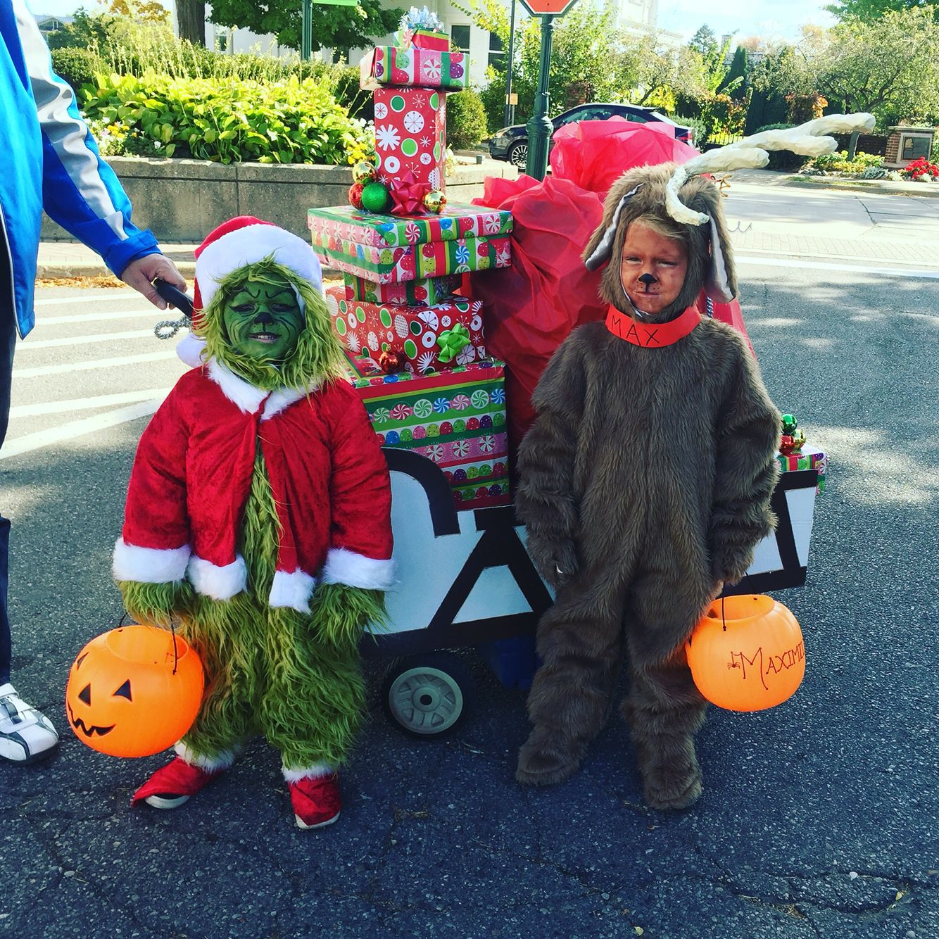 The Grinch and his dog Max, with a sleigh full of stolen