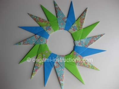 Photo of Origami paper star wreath. Different sizes layered could make a pretty holiday w…