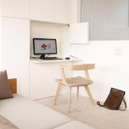 Genial Hidden Home Office With White Bespoke Cupboards, Wood Laminated Flooring  And Wooden Chair
