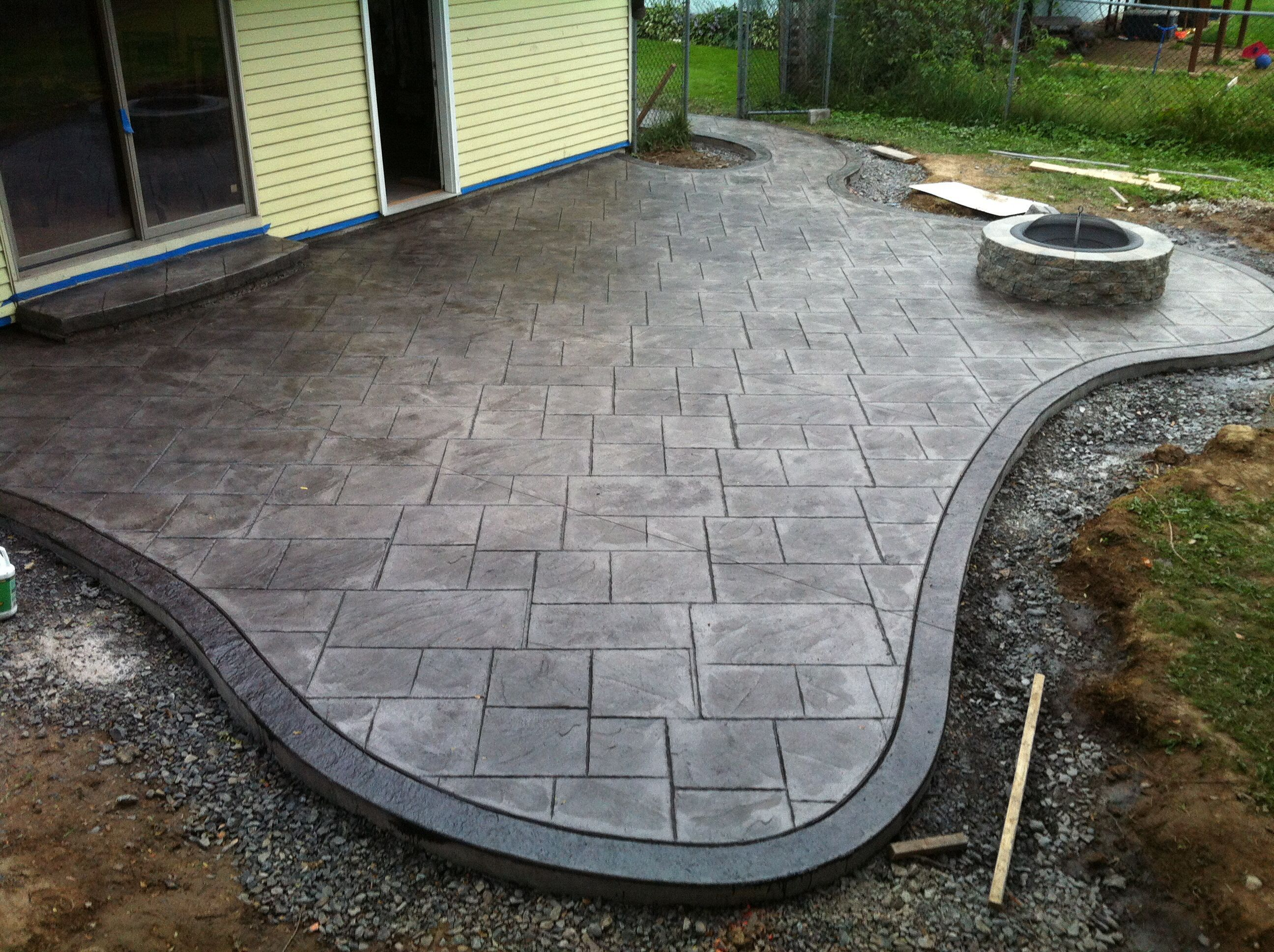 Stamped concrete patio and fire pit large ashlar pattern with seamless slate border by nu crete inc central new york