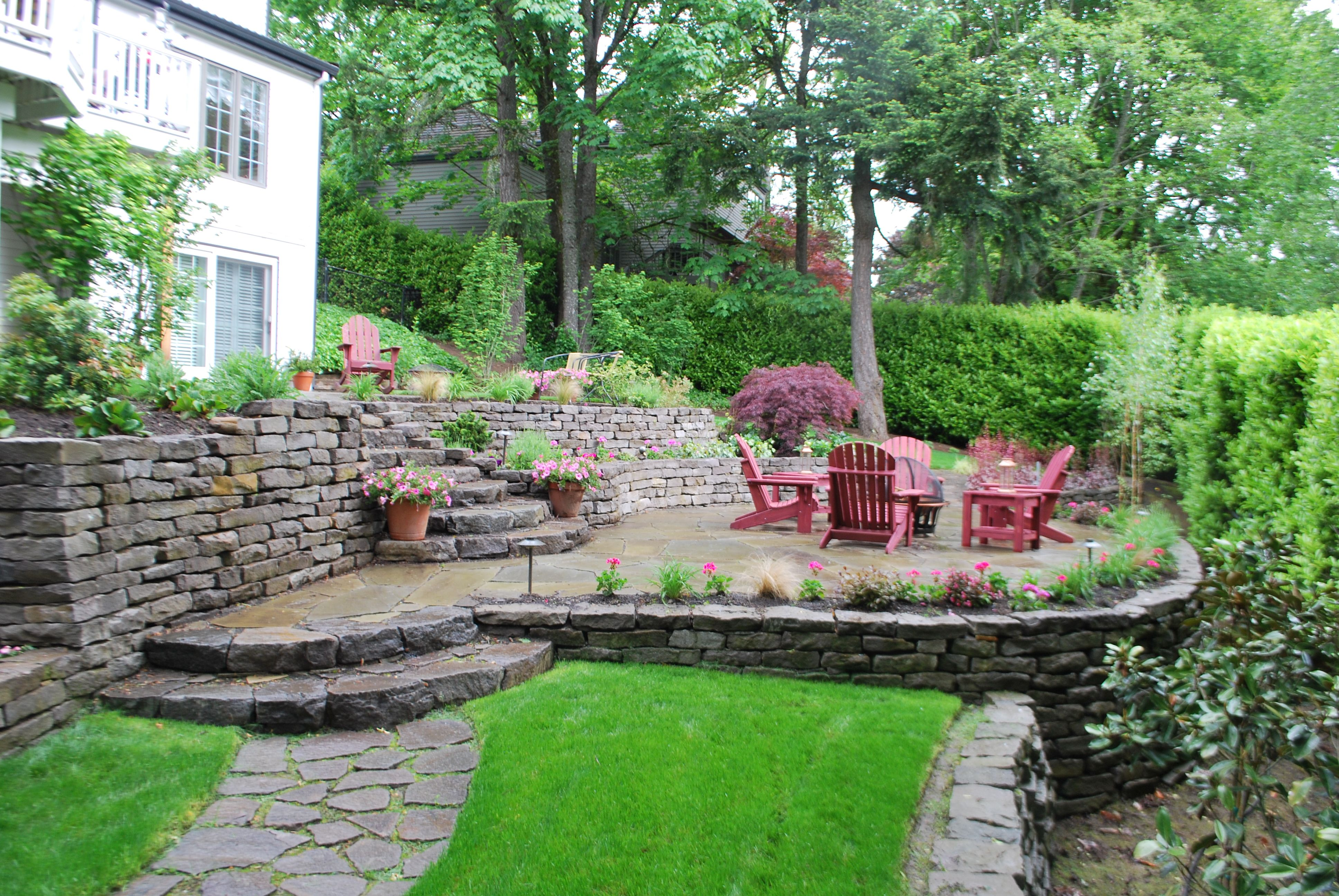 Tiered patio design sloping away from home with ... on Tiered Yard Ideas  id=11483